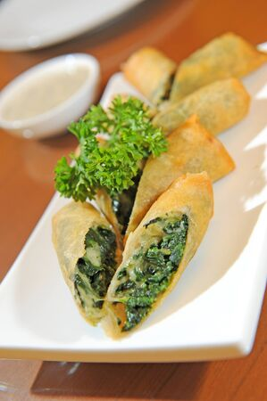 flaky: appetizer pastry with spinach Stock Photo