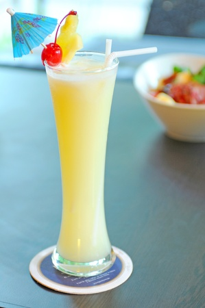 pineapple  glass: Yellow alcohol cocktail with pineapple, lemon Stock Photo