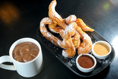 churros chocolate, a typical Spanish sweet snack photo