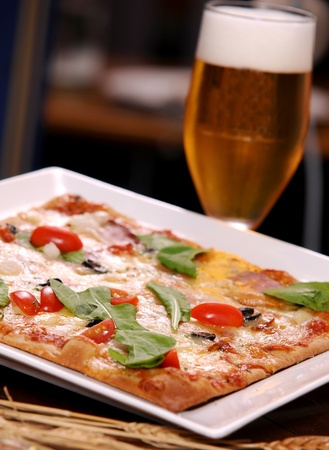 pizza with a glass of beer photo