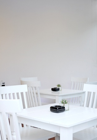 Table and chairs on a white photo