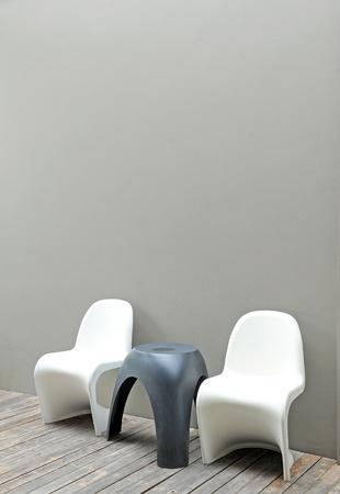 elbow chair: chair against wall