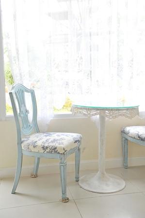 A vintage chair near a window 版權商用圖片