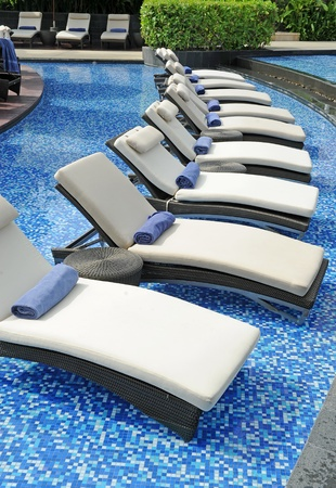 indulging: Beach chairs side swimming pool