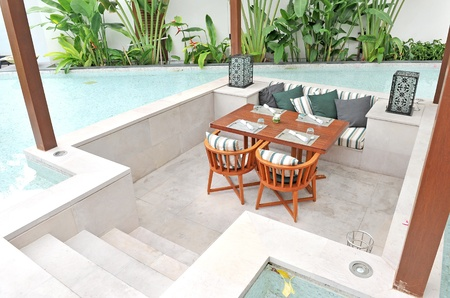Dinning table in swimming pool photo
