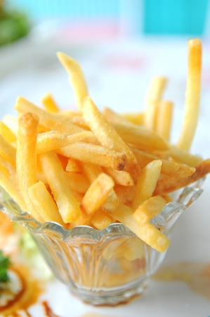 Golden French fries potatoes ready to be eaten Stock Photo - 13343249