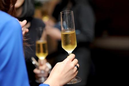 celebration champagne: champagne in hand