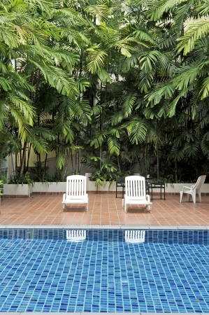 swimming pool and chairs Foto de archivo