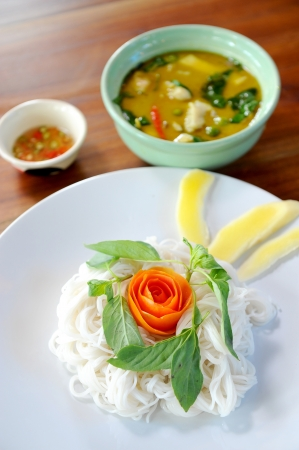 thai style noodle with vegetable and curry photo