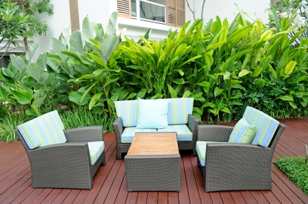 home furniture: Sofa in garden Stock Photo