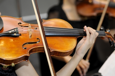 stringed instrument: closeup of a woman playing the violin Stock Photo