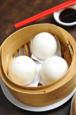sum: chinese dim sum with chopsticks Stock Photo