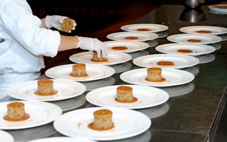 culinary skills: pastry chef is decorating a dessert