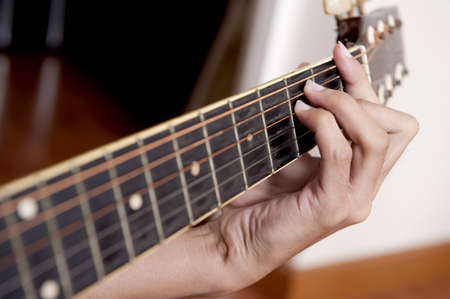 pick light: Playing the Guitar Stock Photo