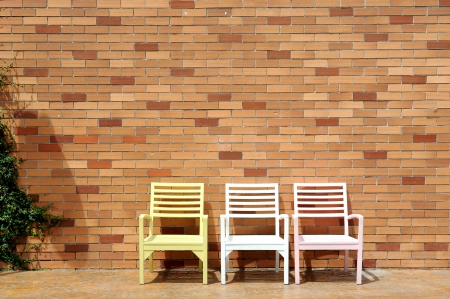 chair and red brick wall photo