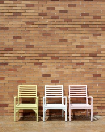 cane chair: chair and wall Stock Photo