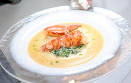 A bowl of creamy delicious lobster