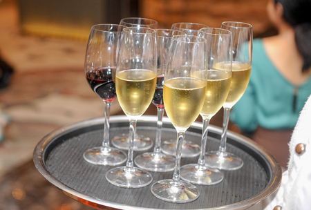 wine glasses on a waiters tray
