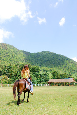 young woman in riding horse Stock Photo