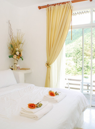Bed with white and flower