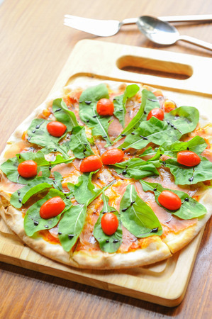 Pizza with cheese, salmon and rocket salad