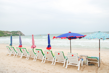 soltería: Beach chairs and umbrellas on sand sea