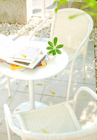 book on the table in garden Banco de Imagens