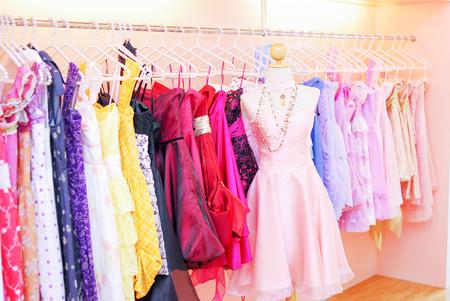 dresses on mannequins in storefront