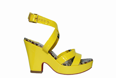 Yellow high heels shoes isolated on white Stock Photo