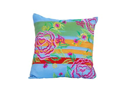 Decorative pillow with flower isolated on white background