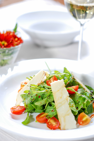 Fresh healthy salad and white wine