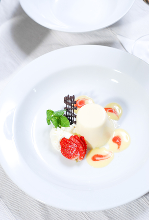 Delicious vanilla pudding  with fresh strawberries