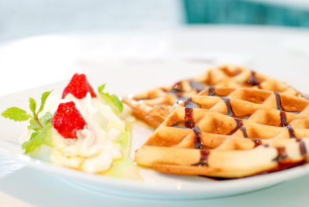 Waffle with whipped cream berry fruit and basil Stockfoto