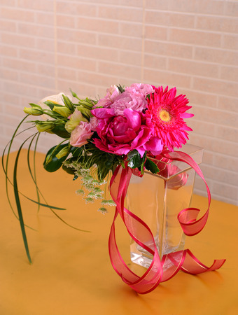 Beautiful bouquet of blossoming flowers and ribbon