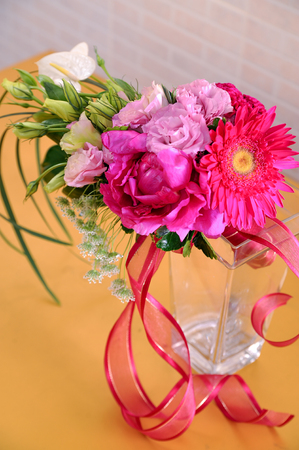 beautiful bouquet and ribbon on glass vase