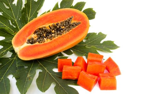 cutaneous: Fresh papaya slice on green leaf. On white background.  Tropical fruit.