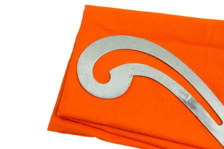 Tailor equipment on orange cloth with white background