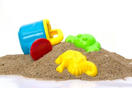 children crab: Toys on sand with isolate Stock Photo