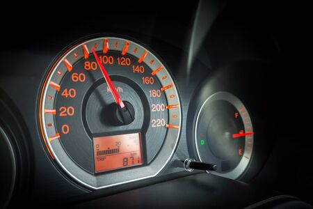 Closeup car dashboard. Speeding on 80 km per hour. Safety speeding. Detail of transportation. Stock Photo