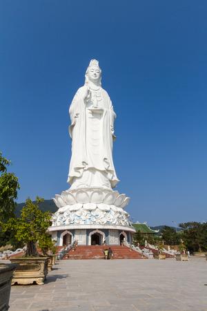 Big Guanyin statue under blue sky in Da Nang, Vietnam photo