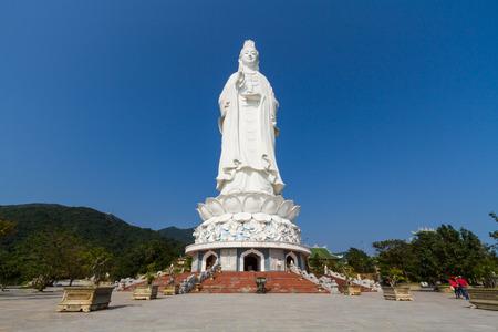 Big Guanyin statue under blue sky in Da Nang, Vietnam Фото со стока