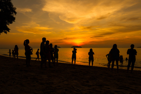 florida beach: Silhouettes of  people enjoing sunset at the Florida beach Stock Photo