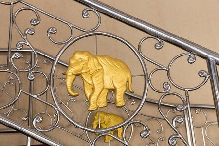 Golden elephant on  stainless steel handrails