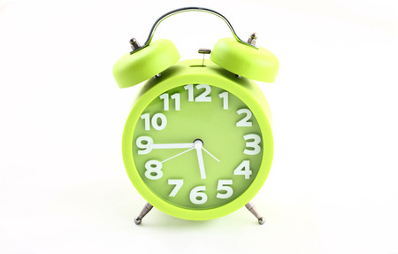 12 oclock: Alarm clock pale green on a white background Stock Photo