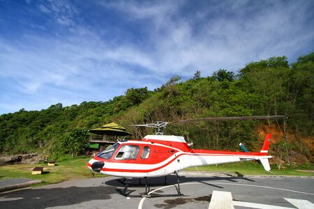heliport: Red Helicopter at a heliport