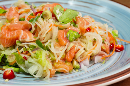 rosmarin: Yum ,Salad with salmon on plate on wood background