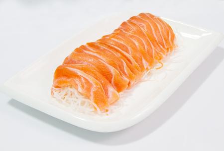 rosmarin: slices of salmon on white plate