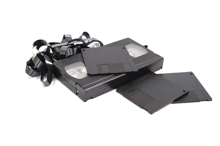 Old technololy video tape recording and floppy disk Stock Photo