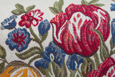embroider flower on fabric texture Stock Photo