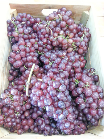 Red grapes are a bunch in wooden crates Stok Fotoğraf